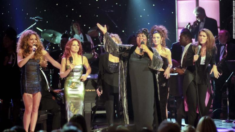 """Franklin performs with, from left, Mariah Carey, Gloria Estefan, Carole King (obscured), Shania Twain and Celine Dion during the """"Divas Live - An Honors Concert for VH1 Save the Music"""" at New York's Beacon Theater in 1998."""