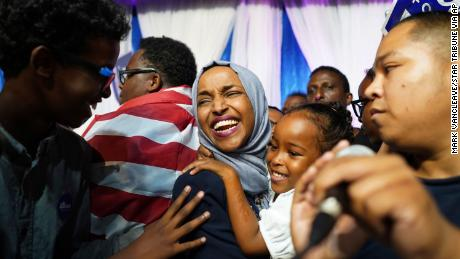 Minnesota Rep. Ilhan Omar, center, celebrates with her children after her Congressional 5th District primary victory.