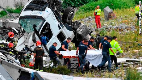 Rescuers recover victims of the bridge collapse on Tuesday.