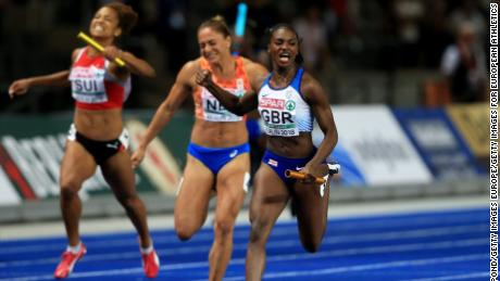 Dina Asher-Smith crossing the line to win gold in the 4 x 100m relay race.
