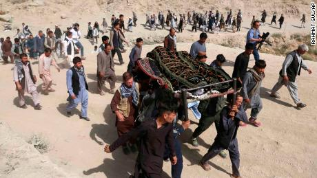 Men carry the coffin of a relative who died in a suicide bombing that targeted a training class in western Kabul, Afghanistan.
