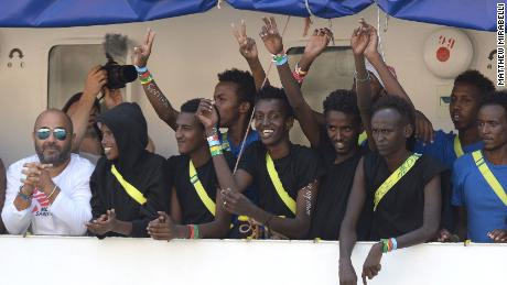 Migrants cheering on the Aquarius rescue ship as it arrived in Senglea, Malta, on August 15, 2018.