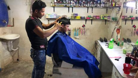 Abdulkadir Halit opened a barber shop in the Rahme Cluster after his shop in Hama was destroyed in airstrikes. He cuts about six heads of hair per day at a cost of 200 Syrian pounds ($2).
