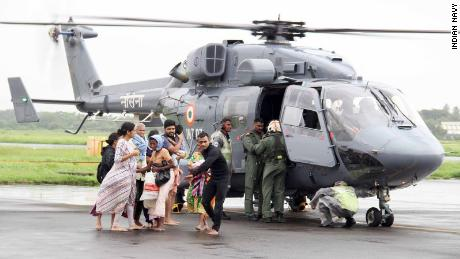 The Indian Navy sends divers with boats and relief items to flood-affected areas.