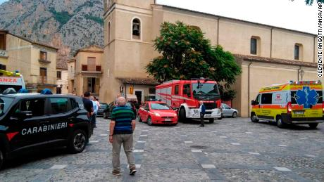 Rescue vehicles gather in Civita on Monday.
