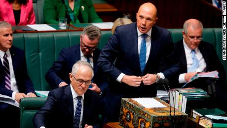 Australia's Minister for Home Affairs Peter Dutton (2nd R) speaks at Parliament as Australian Prime Minister Malcolm Turnbull (bottom L) looks at his notes in Canberra on August 20, 2018.