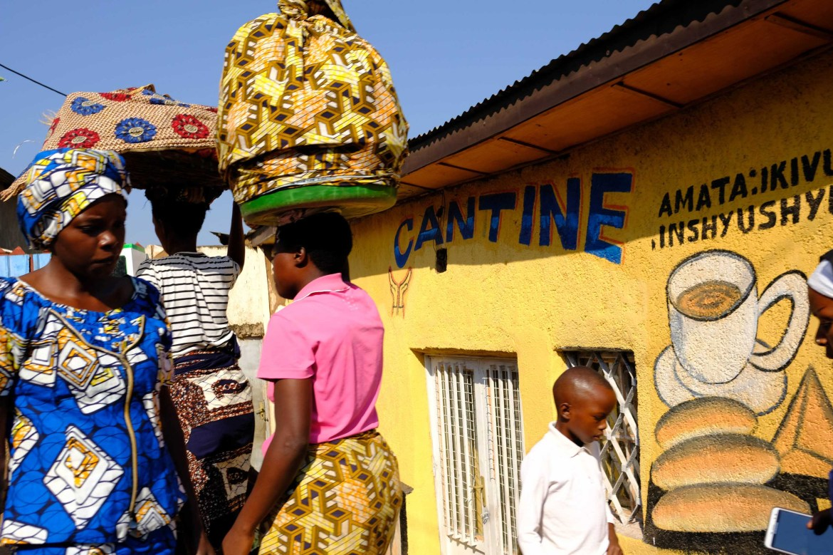 Women make their way to a morning market in Kigali.