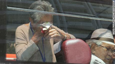 South Korean Lee Keum-seom (L), 92, reacts as she bids farewell through the window to her North Korean son Ri Sang Chol, 71.