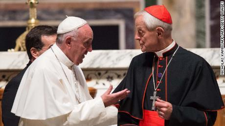 Pope Francis speaks with Cardinal Donald Wuerl during his visit to the US in September 2015.