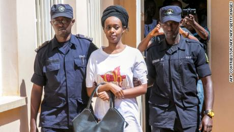Diane Shima Rwigara (C), a prominent critic of Rwanda's President Paul Kagame, is escorted by Rwanda's Police officers as she arrives at the Nyarugenge intermediate court in Kigali on October 6, 2017.  Rwigara was blocked from challenging Kagame in August's presidential election and she had been charged with inciting insurrection against the state as well as other offences.  / AFP PHOTO / Cyril Ndegeya        (Photo credit should read CYRIL NDEGEYA/AFP/Getty Images)