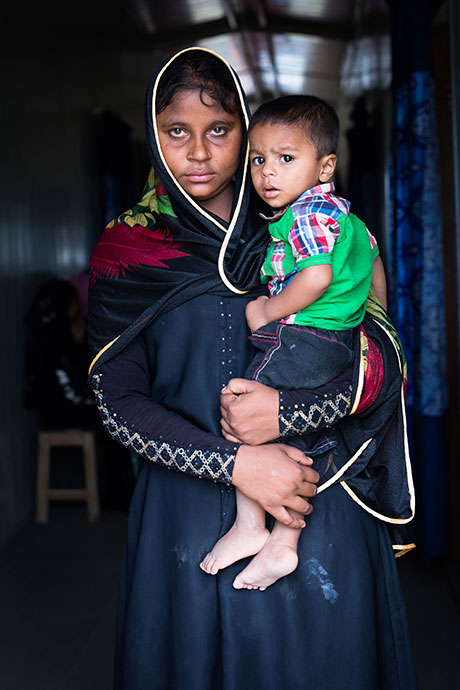 Samuda, a 25-year old refugee, with her son, who was born just one day before she was raped by men dressed in Myanmar military uniforms. The two fled into Bangladesh not long after the attack.