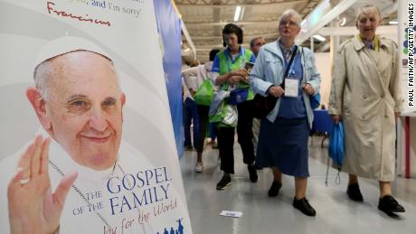 Visitors walk past merchandise on sale at the World Meeting of Families in Dublin.