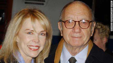 Playwrite Neil Simon arrives at the special screening of 'The Goodbye Girl' with his wife, Elaine Joyce on January 12, 2004, in New York.