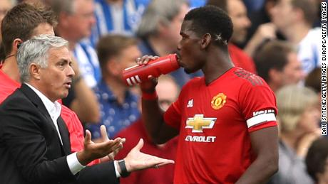Mourinho speaks with Pogba during United's defeat against Brighton.