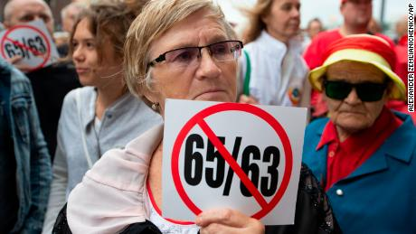 A woman holds a poster protesting an increase in the pension ages from the current 60 to 65 for men and from 55 to 63 for women during a rally in Moscow on August 21.