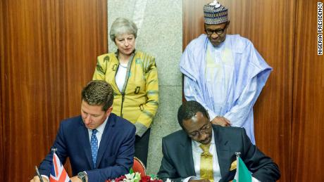 Theresa May and Muhammadu Buhari witness as Nigeria National Security Adviser, Babagana Monguno and British Deputy National Security Adviser, Christian Turner sign the Bilateral Agreement on Defence and Security Partnership in Abuja on August 29, 2018.