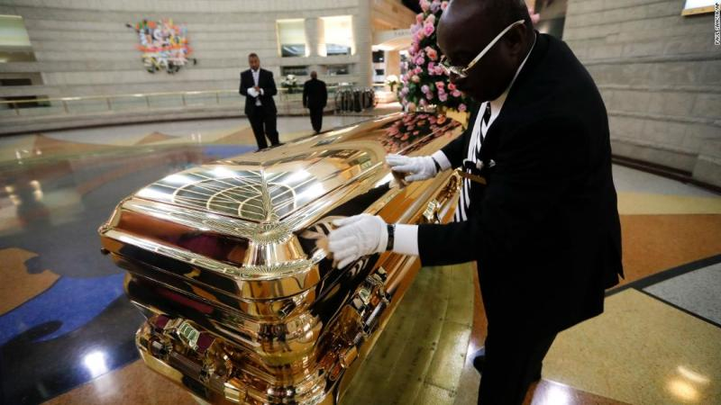 Vincent Street wipes down Franklin's casket on Wednesday.