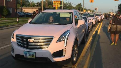 """Pink Cadillac owners line up their cars in Detroit to pay tribute to the """"Queen of Soul."""""""