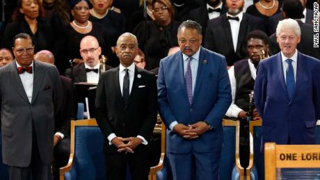 From left, Louis Farrakhan, the Revs. Al Sharpton and Jesse Jackson and ex-President Bill Clinton.
