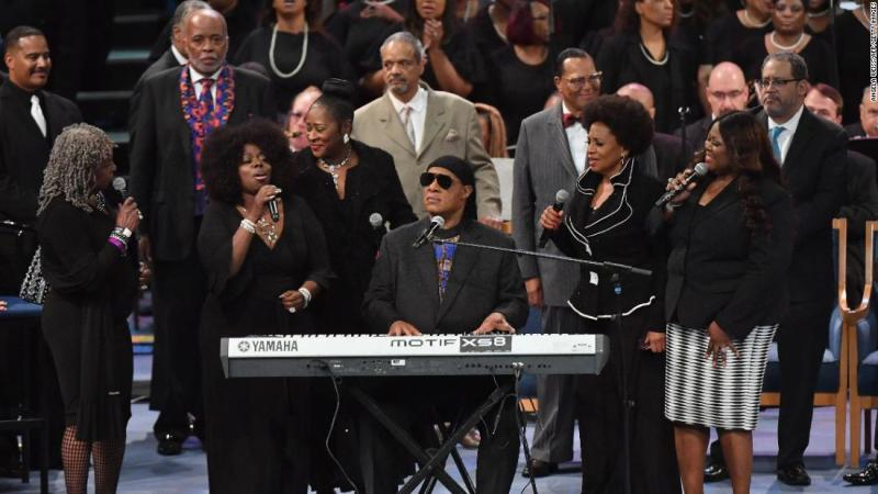 """Stevie Wonder performs at Franklin's funeral on Friday. He began by playing the harmonica before singing, """"I'll Be Loving You Always."""""""