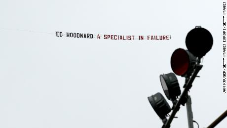 A banner reading 'Ed Woodward a specialist in failure!' is flown over the stadium prior to the Premier League match between Burnley FC and Manchester United at Turf Moor on September 2, 2018.