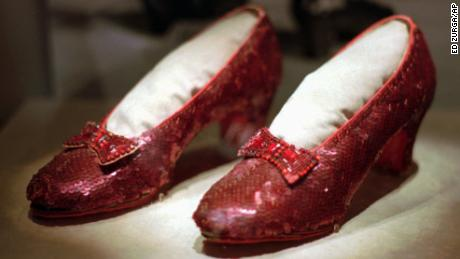"One of several pairs of ruby slippers worn by Judy Garland in the 1939 film ""The Wizard of Oz"" on display during the ""America's Smithsonian"" traveling exhibition in Kansas City, Missouri."