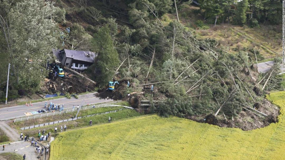 Photo taken Sept. 6, 2018, from a Kyodo News airplane shows the site of a landslide in Atsuma, Hokkaido, northern Japan, triggered by an earthquake with preliminary magnitude of 6.7 that struck the region.
