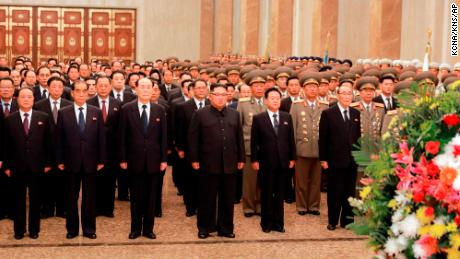 In this photo provided Sunday by the North Korean government, North Korean leader Kim Jong Un, center, visits the Kumsusan Palace of the Sun in Pyongyang, North Korea. Independent journalists were not given access to cover the event depicted in this image distributed by the North Korean government.