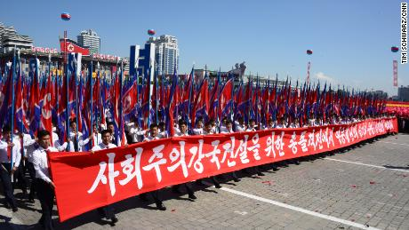 North Koreans march in Kim Il Sung Square as part of Sunday's civilian parade.