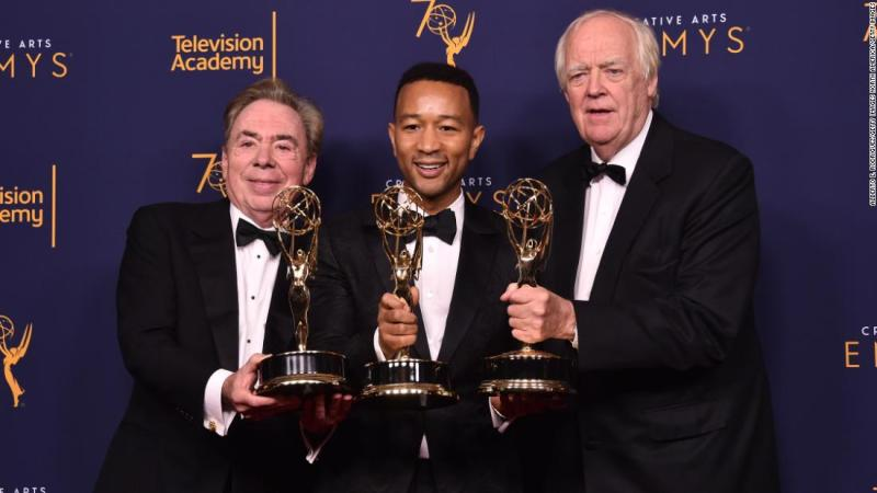 "Sir Andrew Lloyd Webber, John Legend and Tim Price became the latest EGOT winners thanks to ""Jesus Christ Superstar Live in Concert's"" Emmy win for outstanding variety special. Here the trio pose in the press room after their win at the Microsoft Theater on September 9, 2018 in Los Angeles, California."