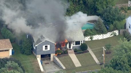 A house goes up in flames on Thursday in northeastern Massachusetts, north of Boston.