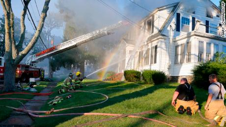 Firefighters are fighting a house fire Thursday in North Andover, Massachusetts.