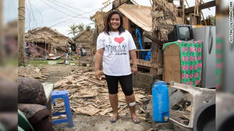 Adelfa Lunato, 23, returned to find her home in ruins.