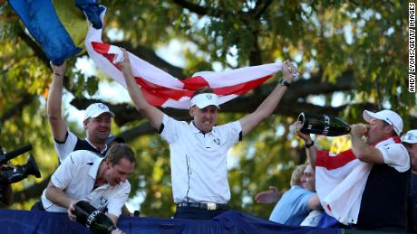 """Poulter celebrates with European teammates after the """"Miracle at Medinah."""""""