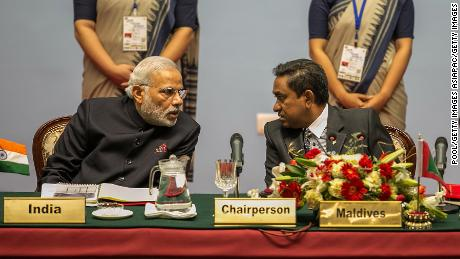 Indian PM Narendra Modi speaks to Maldives President Abdulla Yameen during the inaugural session of the 18th SAARC Summit on November 26, 2014.