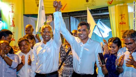 Maldives' opposition presidential candidate Ibrahim Mohamed Solih and running mate Faisal Naseem celebrate their presumed victory in the presidential election.