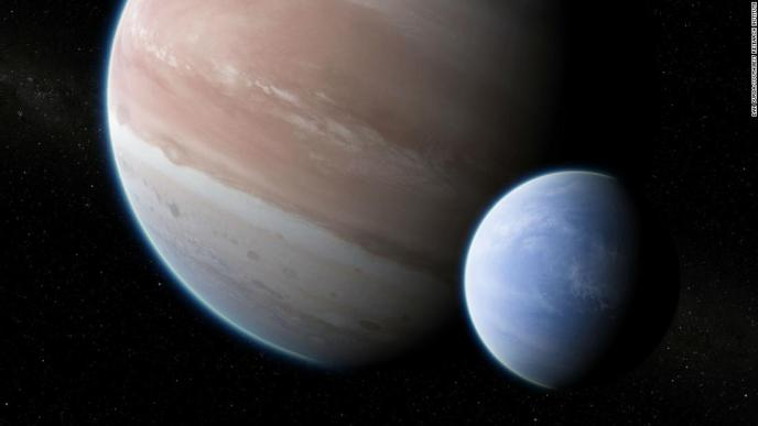 This is an artist's illustration of what a Neptune-size moon would look like orbiting the gas giant exoplanet Kepler-1625b in a star system 8,000 light-years from Earth. It could be the first exomoon ever discovered.