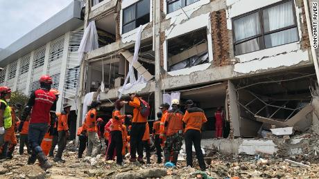 Rescuers looking for survivors in the Mercure hotel in Palu on Thursday, October 4