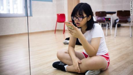 Yang Fang Chi, 17 years old, practices her singing before class at Global K.