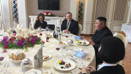 US Secretary of State Mike Pompeo, center, dines with North Korea's Kim Jong Un after their meeting Sunday.