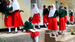 Girls gather between lessons at Arusha Secondary School. At least once a semester, after coming back from holidays, the girls are rounded up in the dining hall for a mandatory pregnancy test.
