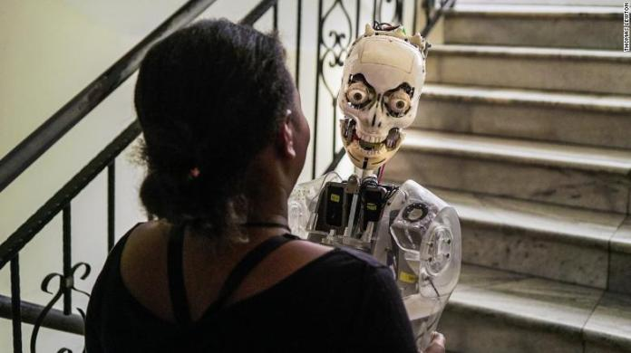 Betelhem Dessie carries a prototype of Sophia the robot at iCog Labs. Image: Thomas Lewton.