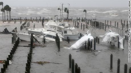 The hurricane damages boats at the Port St. Joe Marina on Wednesday.