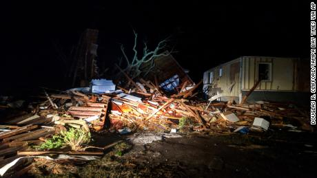 The hurricane leaves a trail of debris in Mexico Beach early Thursday.