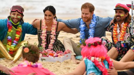 "The duke and duchess join a circle during a ""Fluro Friday"" session run by OneWave at Sydney's iconic Bondi Beach on October 19."