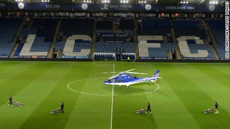 In this file photo taken on April 29, 2015, a helicopter reportedly owned by Vichai Srivaddhanaprabha, the owner of Leicester City football club lands on the pitch after a match between Leicester City and Chelsea at King Power Stadium.
