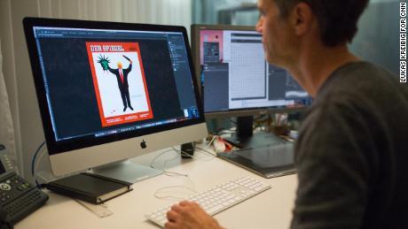 Johannes Unselt, a graphic designer at Der Spiegel, pulls up a controversial Trump cover.