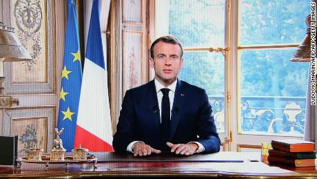 A photo taken on November 4, 2018 in Paris shows a TV screen displaying French President Emmanuel Macron delivering a speech after the results from an independence referendum in the French Pacific territory of New Caledonia.