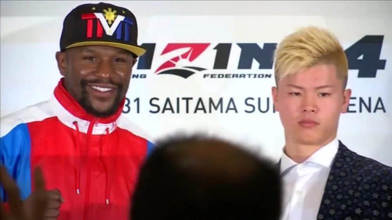 Mayweather and Nasukawa pose during a press event in Tokyo to announce the fight.