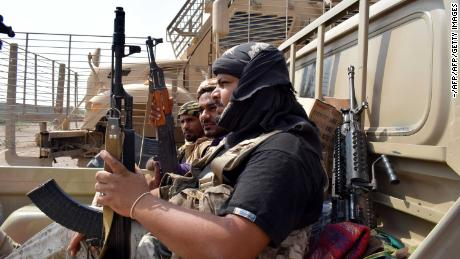 Yemeni pro-government forces advance Tuesday to the port area from the eastern suburbs of Hodeidah.